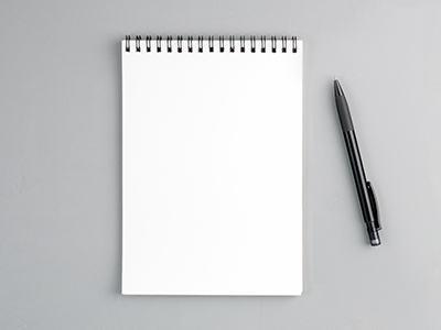 A blank notepad and pen